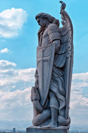 Statue of the Archangel Michael stands on top of Tepeyac Hill near the Basilica of Guadalupe in Mexico City Stock Photo