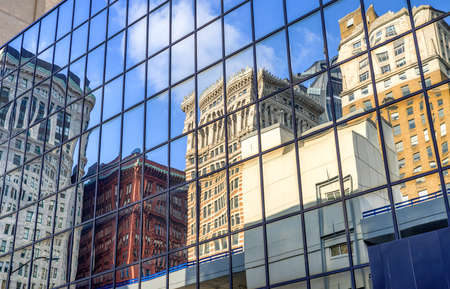 Reflection of buildings in financial downtown district at beautiful sunny day with blue sky in Pittsburgh, Pennsylvania, USA Imagens