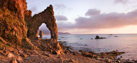 Panoramic. view of Sunrise on headland Velikan, Island Sakhalin, Far East, Russia 스톡 콘텐츠
