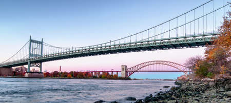 Panoramic view of Hell Gate Bridge and Triborough Bridge at night, in Astoria, Queens, New York. USA
