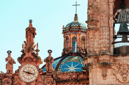 clock on Santa Prisca church in Taxco, Guerrero, Mexico