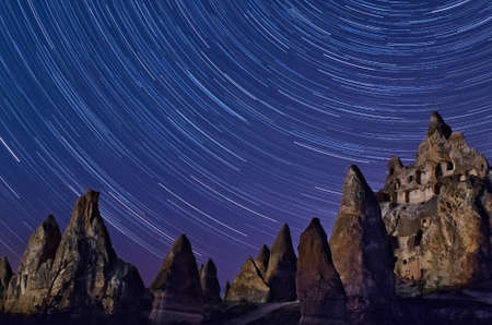 Night Mountain landscape with stars in Cappadocia, Turkey.