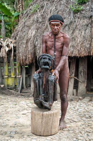 Papua Province, Indonesia -December 28, 2010: Mummy of an ancestor during a ceremony in a village near Wamena, New Guinea Island Editorial