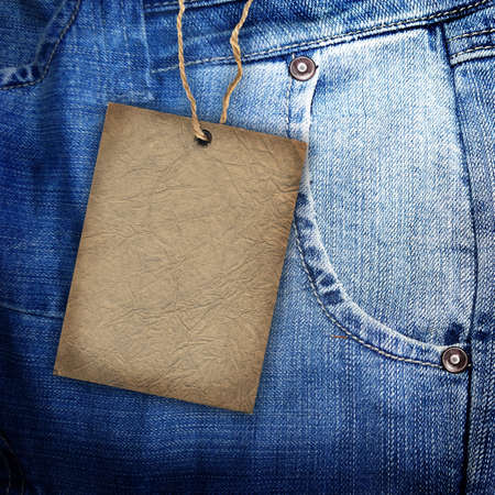 jeans fabric: Background denim texture with cardboard label