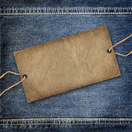 Background denim texture with cardboard label photo