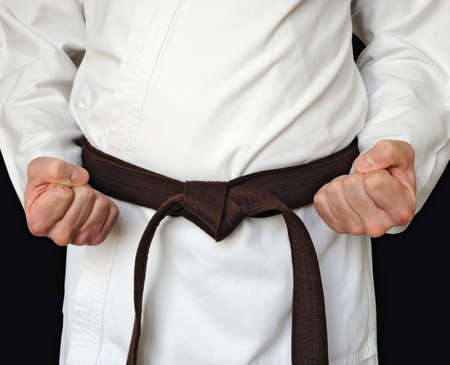 black belt: Man in a kimono and belt for martial arts