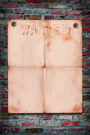 Wanted notice paper on old brick background Stock Photo - 16279181