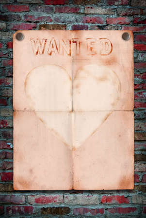 Wanted notice paper on old brick background Stock Photo - 16279179