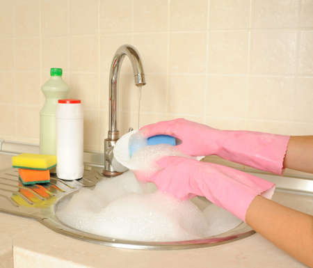 Women�s hands washing dish in the kitchen Stock Photo - 16279322