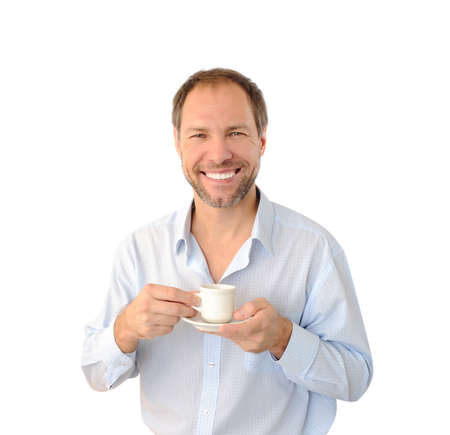 bracing: Smiling man drinking coffee isolated on white background Stock Photo