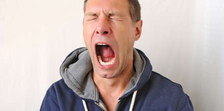 Portrait of the yawn man photo