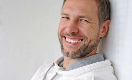 1 mature man: Portrait of smiling man in white