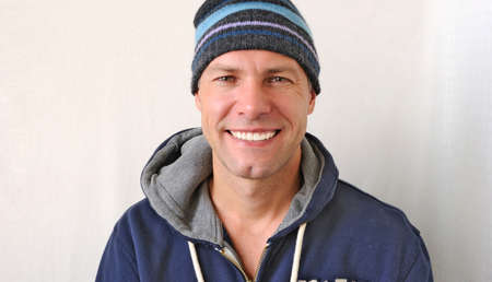 cute guy: Portrait of the smiling man wearing a knitted hat