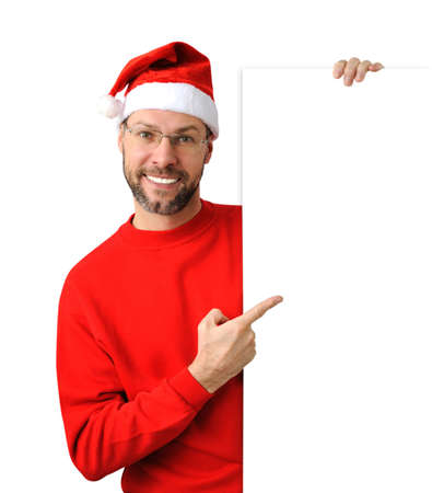 Smiling christmas man wearing a santa hat isolated on the white background Stock Photo - 16690796