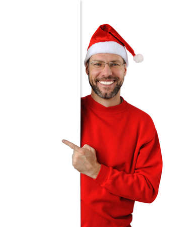 Smiling christmas man wearing a santa hat isolated on the white background Stock Photo - 16690790