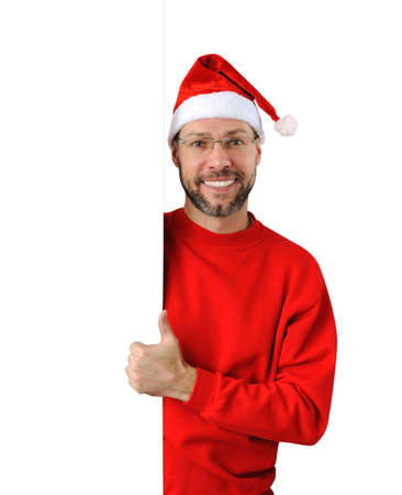 Smiling christmas man wearing a santa hat isolated on the white background Stock Photo - 16690791