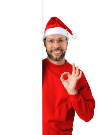 Smiling christmas man wearing a santa hat isolated on the white background Stock Photo - 16690795