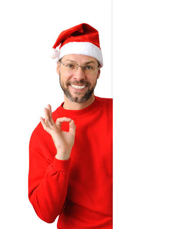 Smiling christmas man wearing a santa hat isolated on the white background Stock Photo - 16690794