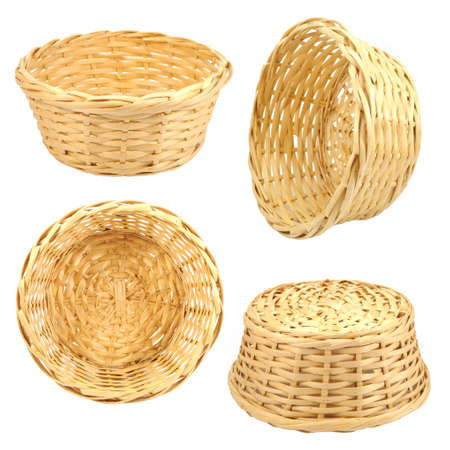 empty basket: Round woven straw basket isolated on the white