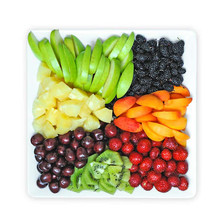 Fruit and berry mix on a white plate photo
