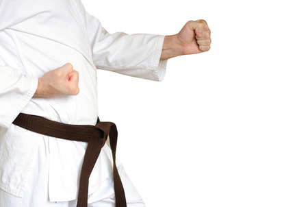 Man in a kimono and belt for martial arts on the white background