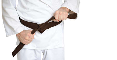 dojo: Man in a kimono and belt for martial arts on the white background