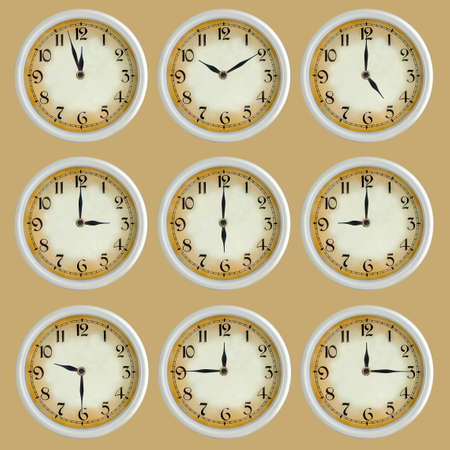 Vintage retro clock set isolated on the gray photo
