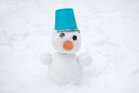 Snowman with blue bucket on the head Stock Photo - 17314226