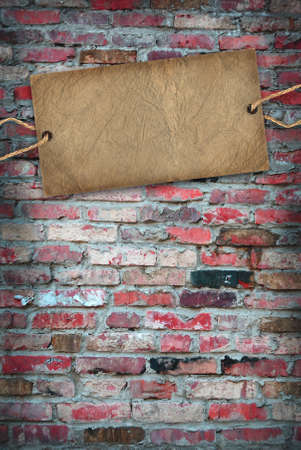 Brick wall with cardboard label retro photo