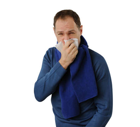 morbus: Man blowing his nose isolated on white background