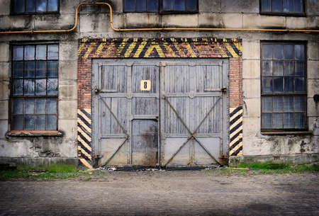 Abandoned old factory with closed door and windows Stock Photo