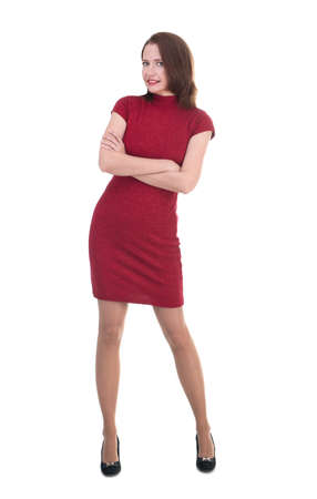 Woman in a little red dress on white background Stock Photo
