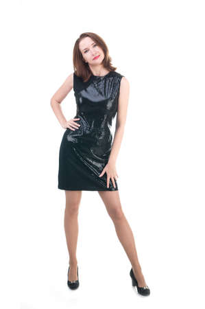 Middle age woman in a little black dress on white background photo
