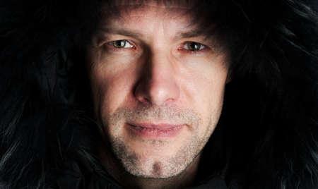 Mans portrait in winter fur hood photo