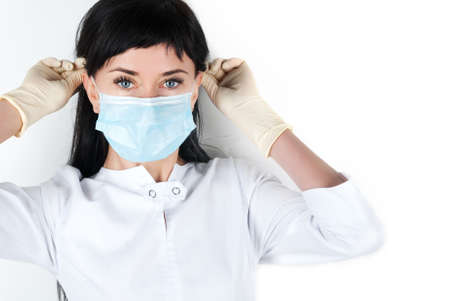 gloves nurse: Woman doctor raised his finger up isolated on white background Stock Photo