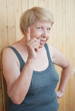 threatens: Funny elderly woman threatens you finger Stock Photo