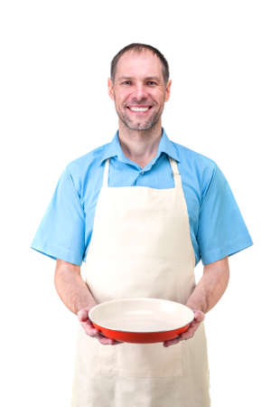 Handsome man holding a dish for your photo