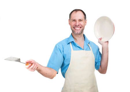 Handsome man holding a dish and a blade photo