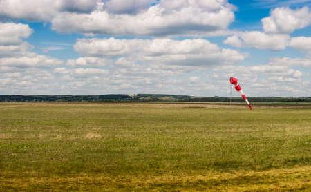 aerodrome: Aerodrome with a weather vane. Blue sky with white clouds Stock Photo
