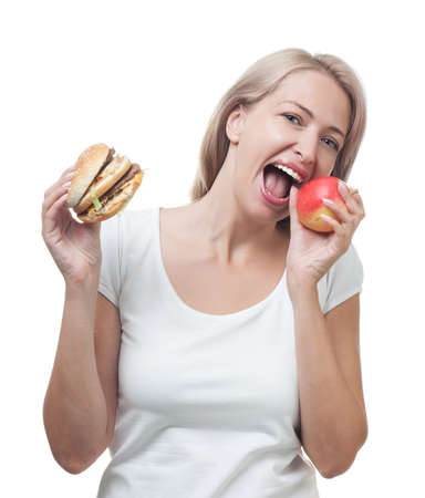 Girl chooses apple not a burge risolated on white background  photo