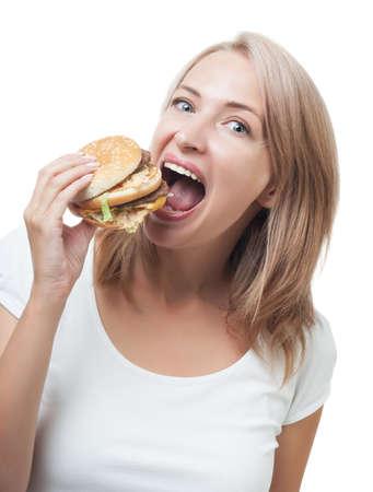 Funny girl eating burger isolated on white background photo