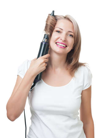 Beautiful girl doing hairstyle with hair brush photo