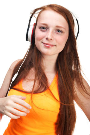red haired girl: Girl listening  music on headphones. Isolated on white background