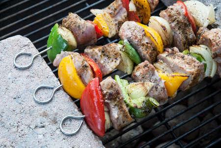 meat skewers: BBQ with kebab cooking. coal grill of lamb meat skewers