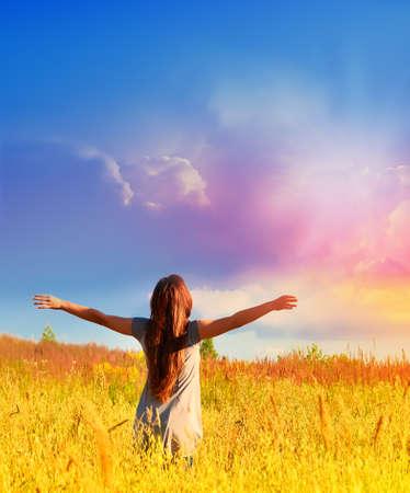happy healthy woman: Free happy woman enjoys freedom on sunny meadow. Nature. Stock Photo
