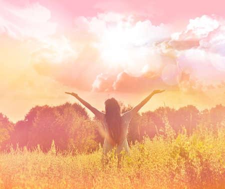 enjoying life: Happy woman in wreath outdoors summer enjoying life opening hands.