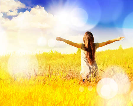 Free happy woman enjoys freedom on sunny meadow. Nature. Reklamní fotografie