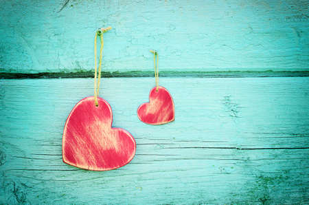 Two hearts on a blue wooden background