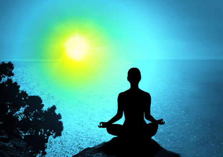 meditation man: Yoga and meditation. Silhouette of man on the peak of the mountain Stock Photo