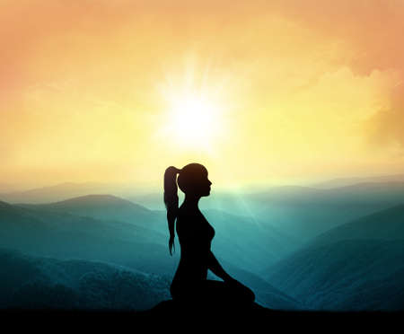 colorful sky: Women meditating on high mountain in sunset background. Yoga and meditatuon